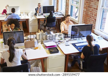 Wide Angle View Of Busy Design Office With Workers At Desks #289559477