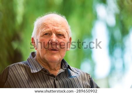 Portrait of senior man outdoors #289650902