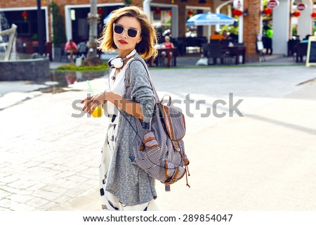 Summer sunny lifestyle fashion portrait of young stylish hipster woman walking on the street, wearing cute trendy outfit, drinking tasty smoothie, smiling enjoy her weekends, travel with backpack/ #289854047
