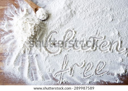 Word gluten free on wood board with flour #289987589
