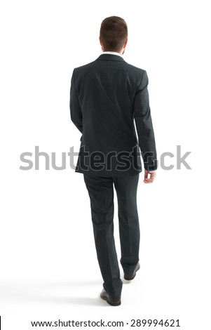 back view of walking businessman in black suit. isolated on white background #289994621