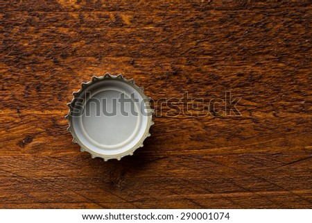 bottle cap from a beer bottle on wooden background