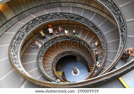 People climbing down the stairs of the Vatican Museums in Vatican, Rome, Italy Royalty-Free Stock Photo #290009939