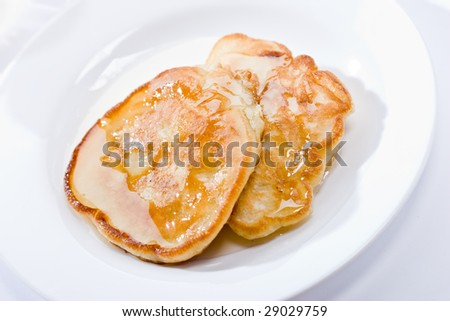 Two pancakes with honey on plate, lunch #29029759