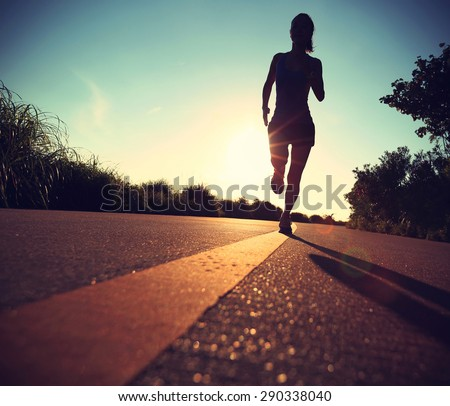 young fitness woman running on sunrise seaside trail,vintage effect #290338040