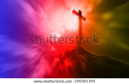 A wooden cross on a hill at sunset with radial blur #290381399