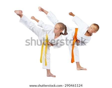 Young sportsmens beats kick Yoko geri on a white background #290461124