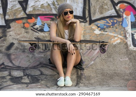 Beautiful and sexy street girl with her skateboard #290467169
