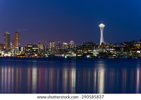 Seattle Skylines with light reflection on Lake Union in blue hour. The view from Gas Works Park a tourists attraction and popular local place.