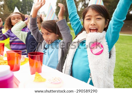Group Of Children Having Outdoor Birthday Party #290589290