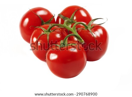 Red fresh tomatoes on a green branch in drops of water on a white background isolation #290768900