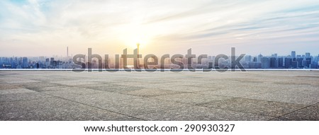 Panoramic skyline and buildings with empty concrete square floor Royalty-Free Stock Photo #290930327