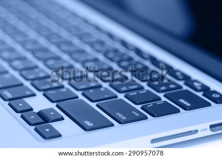 closeup image of laptop keyboard on the table #290957078