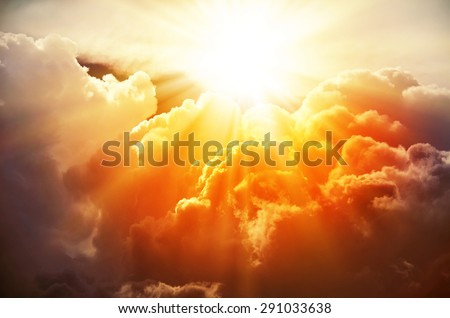 The bright rays of the sun are shining from saturated clouds