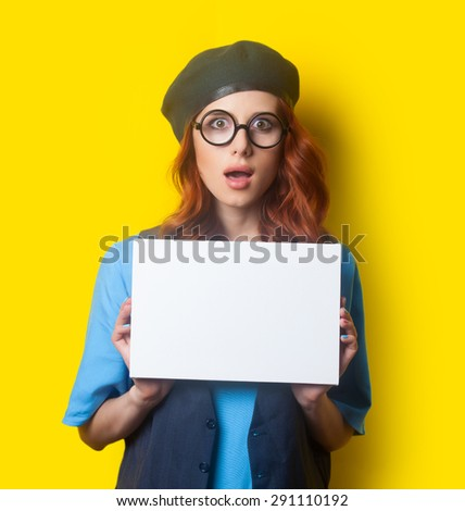 Surprised redhead girl with white board on yellow background #291110192