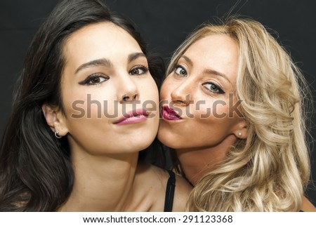 Portrait of Two Beautiful Young Woman Over Black Background #291123368
