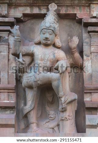 Thanjavur, India - October 13, 2013: The evening descends on dwarapalaka statue on entrance Gopuram at Brihadeswarar temple.  #291155471