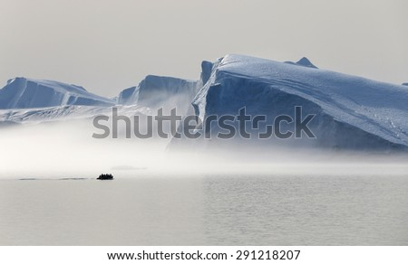 Nature and landscapes of Greenland. Travel on the scientific vessel among ices. Studying of a phenomenon of global warming. Ices and icebergs of unusual forms and colors.  #291218207