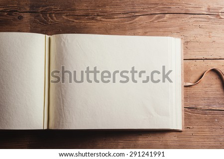 Photo album with an empty space for photos. Studio shot on wooden background. Royalty-Free Stock Photo #291241991