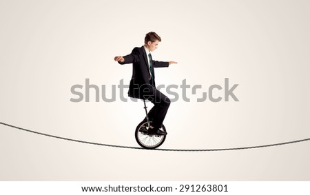 Extreme business man riding unicycle on a rope concept on background #291263801