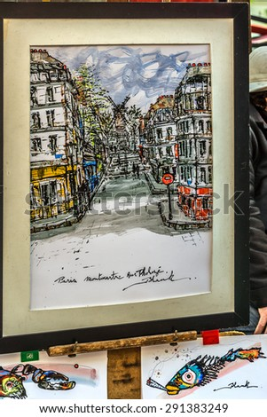 PARIS, FRANCE - MAY 15, 2014: Artists easels and artwork set up in Place du Tertre in Montmartre. Montmartre attracted many famous modern painters in the early 20th century. #291383249