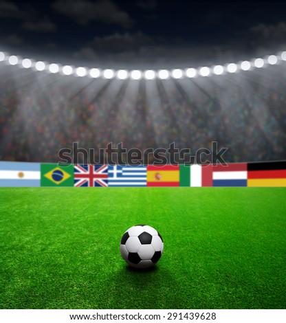 Soccer ball on green stadium, arena in night illuminated bright spotlights #291439628