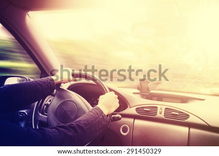 Vintage toned picture of a driving car interior, space for text. #291450329