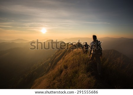 People walking above hill. Royalty-Free Stock Photo #291555686
