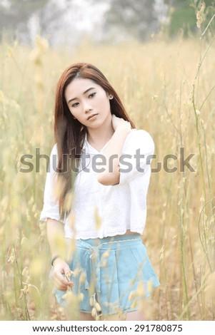 Asian girl on wheat field #291780875