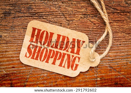 Holiday shopping  sign a paper price tag against rustic red painted barn wood #291792602