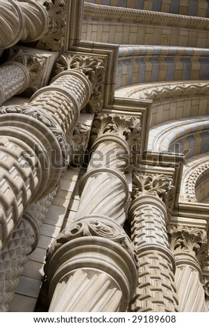 Ornately decorated pillars of the entrance way at Victoria and Albert museum, London UK #29189608