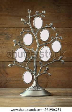 Image of vintage antique classical frame of family tree on wooden table. 7 frames