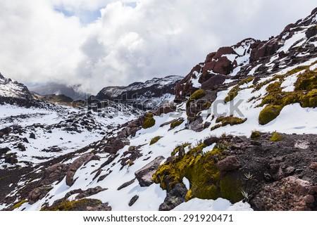 Fresh snow on rocks, Cayambe volcano, Ecuador #291920471