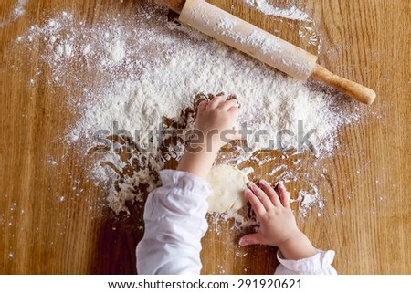 Child's hands playing with the flour #291920621