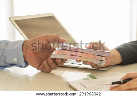 Business loan from a bank employee. finance concept Royalty-Free Stock Photo #291968042