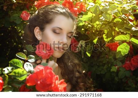 Retro woman portrait in beauty pink roses garden. #291971168