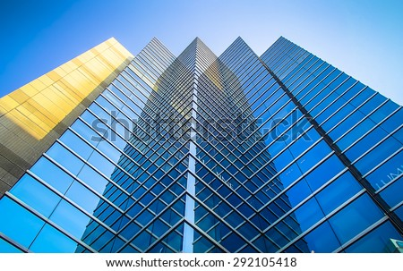Perspective and underside angle view to textured background of modern glass  blue building skyscrapers roof #292105418
