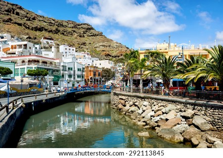 View of canal and street in Puerto Mogan. Gran Canaria. Spain Royalty-Free Stock Photo #292113845