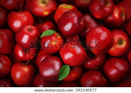 Red apples background Royalty-Free Stock Photo #292140977