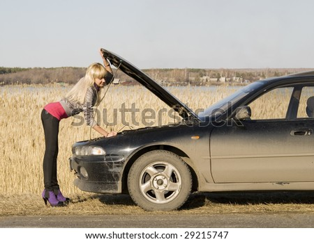 young pretty woman with her broken car #29215747