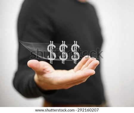 man catches virtual dollar sign, concept of income,salary,earning #292160207