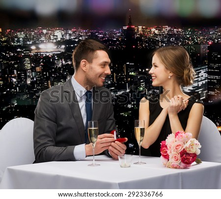 restaurant, couple and holiday concept - smiling man proposing to his girlfriend at restaurant #292336766