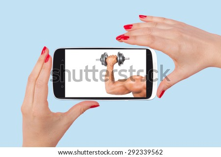 Online dating. Female hands holding smartphone with picture of handsome man isolated on pink background. Flirting and relationship in the information age. Royalty-Free Stock Photo #292339562