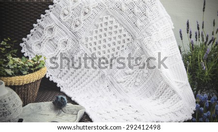 Crochet, Cable Knit Afghan Baby Blanket in White on Sofa with Lavender,  closeup Soft Focus High Contrast Desaturated Grunge Filtered #292412498