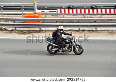FRANKFURT,GERMANY - APRIL 16:unknown rider on the highway on April 16,2015 in Frankfurt, Germany #292514738