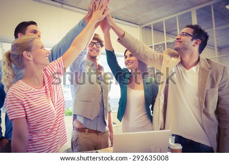 Happy business team doing hands checks in the office #292635008