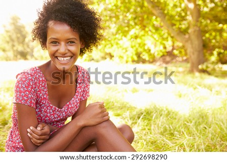 Young woman sitting on grass relaxing #292698290