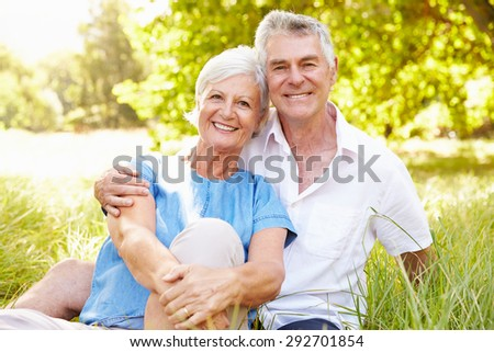 Senior couple sitting on grass together relaxing #292701854