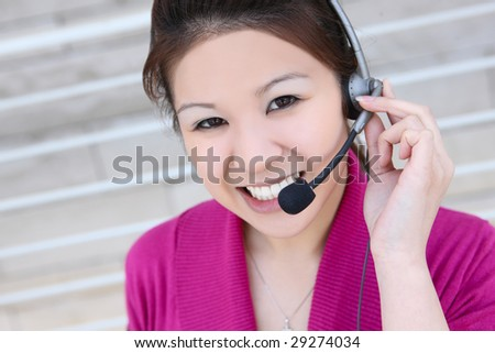 An asian customer service employee thinking and listening to the client #29274034