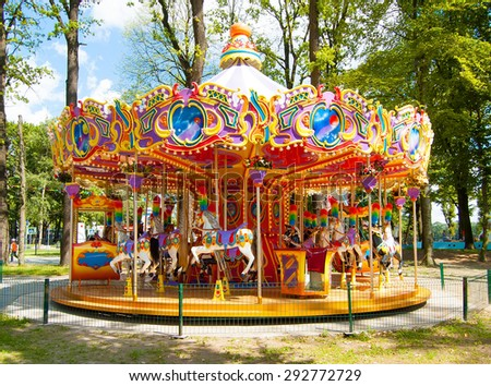 Colourful carousel in the Park Royalty-Free Stock Photo #292772729